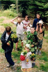 Children at summer camp learning to identify common trees and flowers.